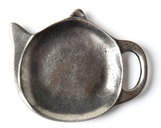 This cute teapot-shaped teabag holder is from Quirky Me for 60 Bucks. Isn't it just adorable? You can also keep it next to your stove to place your messyutensilson while cooking. Or even on your serving tray for all the used teaspoons.