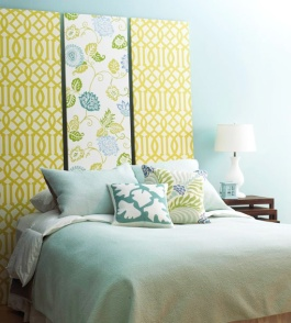 Complementary wallpaper panels creates a striking headboard | via http://www.bhg.com
