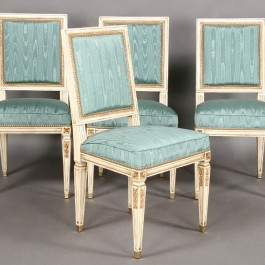 The moiré pattern of these watered silk chairs has an almost timber grain effect.