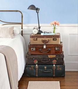 The perfect shabby chic bedside table - stacked vintage suitcases | via http://www.countryliving.com/