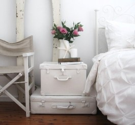 Fresh and beachy - these suitcases has been painted white   via http://www.abeachcottage.com/