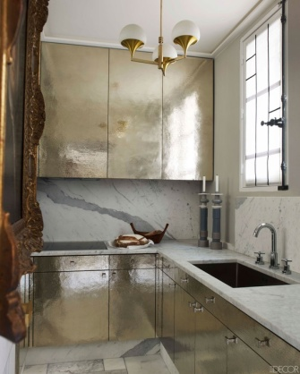 Designer Jean-Louis Deniot's hammered silver kitchen | via http://www.elledecor.com/design-decorate/hammered-silver-cabinetry#slide-9