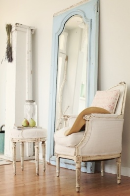 Simply adore this old door mirror painted in a fresh blue - it compliments the rustic french furniture perfectly! | via http://dreamywhites.blogspot.com/2010/10/chair-makeover.html