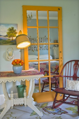 Shannon Quimby transformed this old french patio door into a quirky brightly-painted full-length mirror! | http://www.oregonlive.com/hg/index.ssf/2009/06/change_out_glass_for_mirrors_i.html