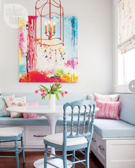 Built-in banquette seating with a fixed back and storage below | via http://www.styleathome.com/homes/interiors/interior-light-and-lively-family-home/a/50888/3