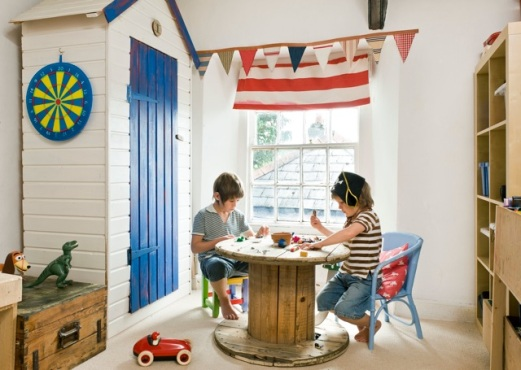 Love this nautical little room with the bunting and a cable spool as an activity table! So clever! | via http://www.thebooandtheboy.com/2012/01/coastal-boys-room.html