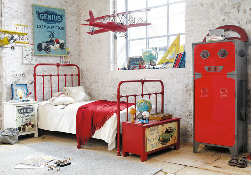 LOVE this gorgeous boy's room with slight industrial & vintage elements. The striking red and yellow colour combo is a cool change from the traditional boy's blue. And what little boy would not love to have airplanes hanging overhead as he drifts to sleep?! | via http://www.maisonsdumonde.com/UK/en/produits/fiche/red-child-s-bed-nicolas-116826.htm