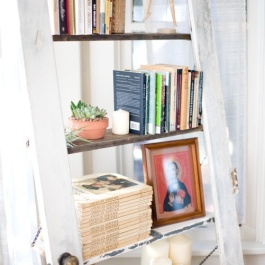 Love this salvaged door with chained shelves where the door panel used to be! | via http://pinterest.com/pin/1548181093148001/