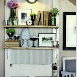 An awesome reclaimed door shelf unit complete with light fitting | via http://www.bulbtoblossom.com/2012/05/30/vintage-door-decorative-functional-illuminating/