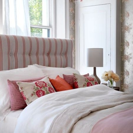 Buttoned headboard with cheerful floral scatters gives a feminine country feel | via http://www.housetohome.co.uk/bedroom/picture/buttoned-headboard