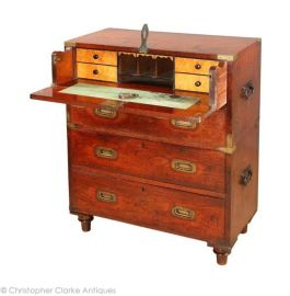 An antique Secretaire Campaign Chest - faux drawers flips down to form a writing desk | via http://www.campaignfurniture.com/archivesdetailspage.asp?stockNo=80529&archive=1