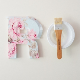 11) Paint a coat of modge podge on the sides of the letter and stick the fabric in place, smoothing it down with the paintbrush. Leave to dry.