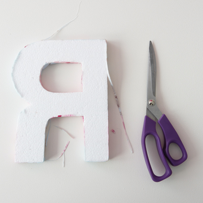 12) Once the modge podge is dry you can turn the letter over and trim away any excess fabric that sticks out at the back with your needlework scissors.