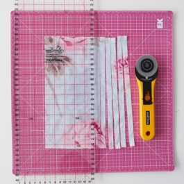 13) Paint a piece of fabric with modge podge on the right side and leave to dry. Now cut the fabric into 15mm strips using a rotary cutter.