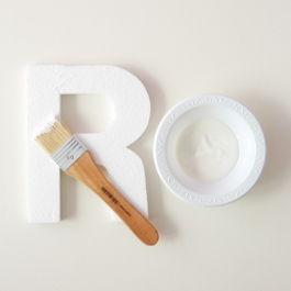 7) Paint the right side of the letter with a layer of modge podge.