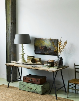 What a beautiful statement for an entryway. All this beat-up salvaged door needed to make it a gorgeous table was a pair of metal trestle legs from Ikea   via http://ysvoice.tumblr.com/post/6571286927/corner-table#.UmEkSXBRpWJ