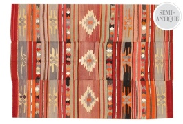 A stitched Turkish kilim from the 1950s featuring a stripe-like design   via https://www.onekingslane.com/product/15241/753183