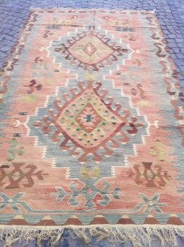 A beautiful vintage Turkish kilim rug in faded pastels with traditional Anatolian patterns. Circa 1930s   via http://www.etsy.com/listing/163375333/organic-dyed-turkish-kilim-rug?ref=shop_home_active