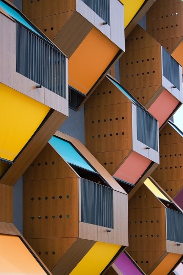 "The geometric shapes found in our cityscapes have indirectly and subconsciously inspired many trends. Adore this colourful ""honeycomb"" housing project in Slovenia by OFIS Architects