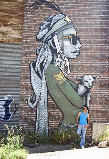 "Stunning urban street art in Johannesburg, South Africa - ""The Lion Sleeps"" by graffiti artist Faith47 