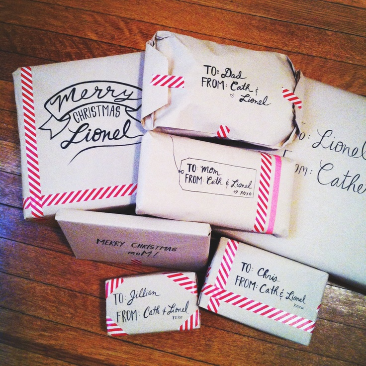 Catherine Cachia shared her Christmas gift wrapping skills with Pinterest. Doesn't get any simpler than this: white paper, striped neon washi tape and some creative penmanship!   via http://www.pinterest.com/pin/177540410282025163/
