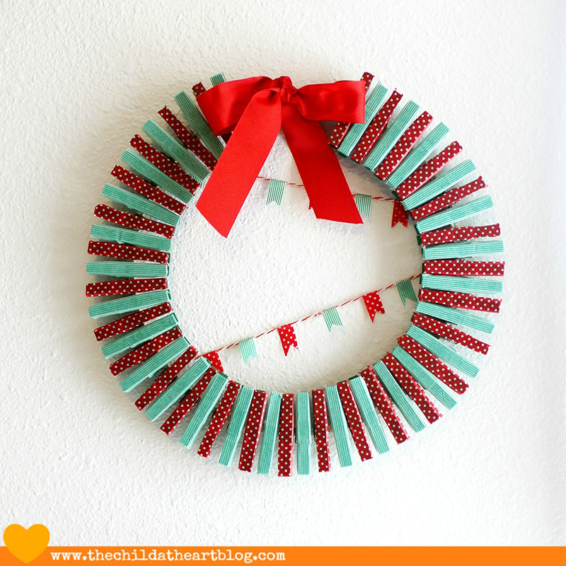 Another washi tape clothes peg Christmas wreath | via http://www.thechildatheartblog.com/2013/12/washi-tapeembroidery-hoop-holiday-card.html