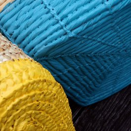 Wouldn't these brightly painted baskets work well as toy storage in a kids room?! | http://spiralstyle.blogspot.com/2011/07/diy-plasti-dip-projects.html