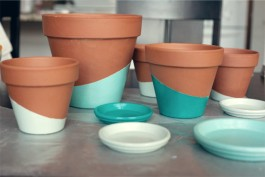 These terracotta pots are beautifully dipped in shades of blue | via http://witandwhistle.com/2013/03/25/diy-color-dipped-pots/