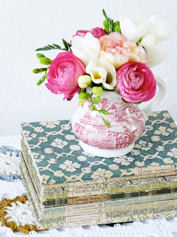 I adore this idea - the collection of flowers are neither big nor grand but put them in this lovely vintage teapot and turns into an eye-grabber! | via http://decor8blog.com/2010/04/28/pretty-flowers/