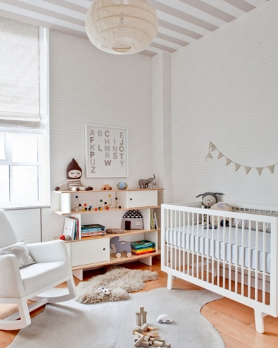 A overly white room can look quite stark, however the addition of texture and pattern ensured that this little nursery looks everything but! Especially love the striped ceiling, understated wallpaper and quirky accessories. | via http://www.designsponge.com/2012/04/mini-sneak-peek-gabriels-nursery.html