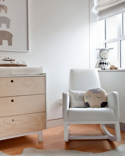 The lovely wood grain of this chest of drawers adds a bit of warmth and the sleek contemporary upholstered rocking chair is simply gorgeous | via http://www.designsponge.com/2012/04/mini-sneak-peek-gabriels-nursery.html