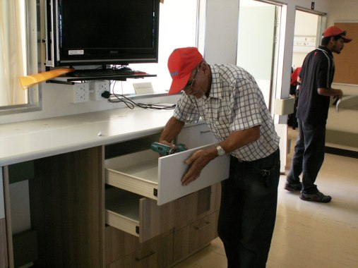 An Easylife Kitchens employee working hard at putting the Ward's new Quick Access Station together.