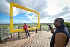 Khayelitsha_residents_Muzikayise_Radebe_poses_for_Mfesane_Cwati_at_the_Lookout_Hill_frame_of_Table_Mountain_in_Khayelitsha_2_1200_799_70_s