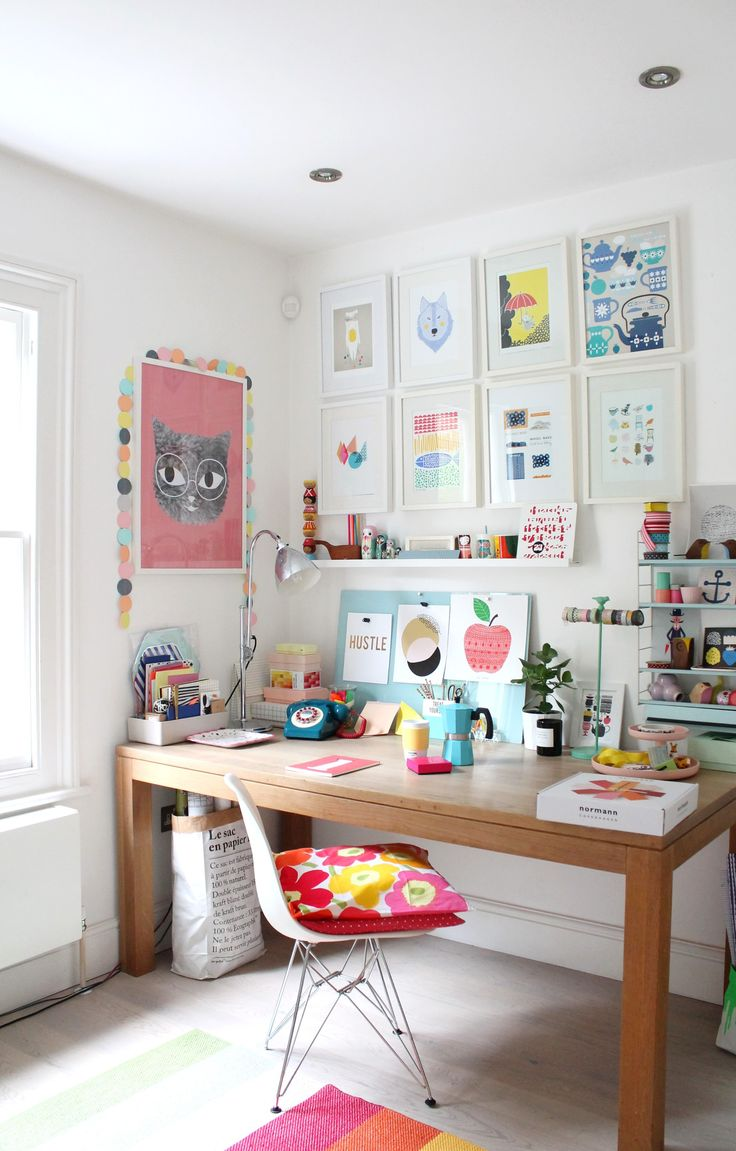 The colourful workspace of Geraldine of Little Big Bell. Simply adore the illustrations! | Source: http://littlebigbell.com/little-big-bells-studio/