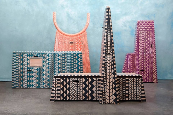 "Kassena Town Cabinets by Dokter & Misses. The three cabinets are shaped to resemble mud buildings that together form a ""village"" of cabinets. Doktor & Misses created the set to look like a small West African town and are hand painted with Kassena-inspired patterning. [To vote SMS MBOISA+KESSENA TOWN to 40619 at a cost of R1.50 per SMS]"